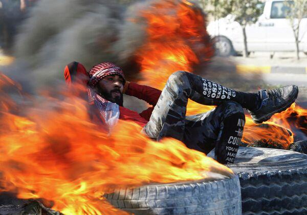 Участник акции протеста в Наджафе, Ирак