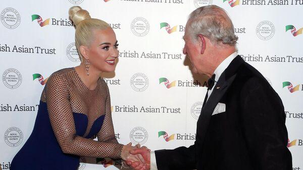 Принц Чарльз и певица Кэти Перри на приеме благотворительной организации British Asian Fund