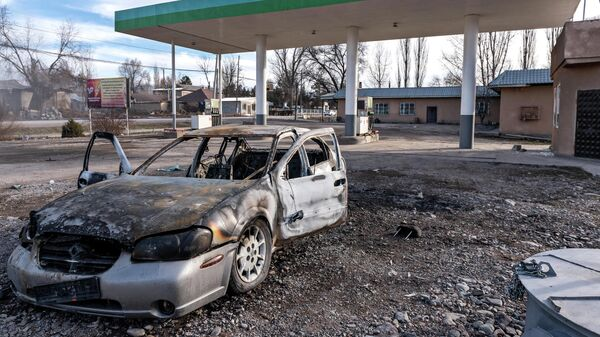 Сгоревший автомобиль на улице поселка Масанчи