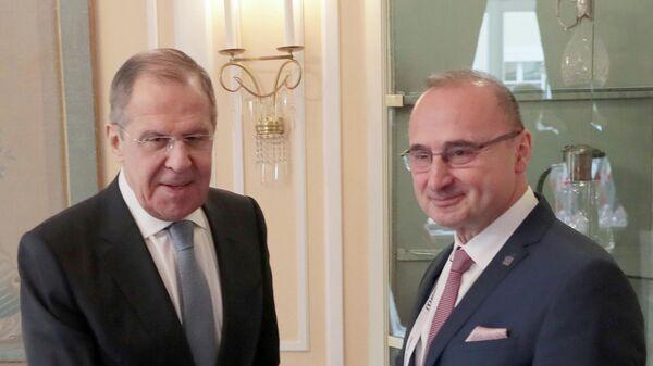 Министр иностранных дел РФ Сергей Лавров (слева) и министр иностранных дел Хорватии Гордан Грлич-Радман во время встречи в Мюнхене.