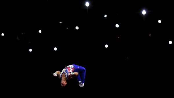 Артур Далалоян (Россия) в командном многоборье среди мужчин на чемпионате мира по спортивной гимнастике в Штутгарте