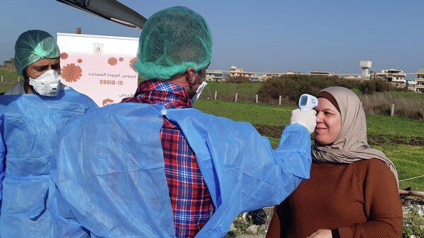 Измерение температуры в связи с распространением коронавируса в Сирии