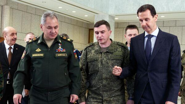 Министр обороны РФ генерал армии Сергей Шойгу и президент Сирийской Арабской Республики Башар Асад во время встречи в Дамаске