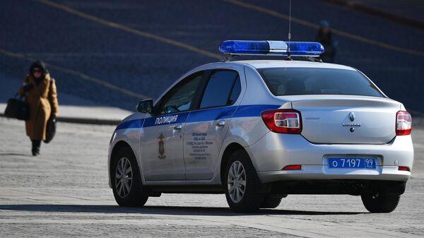 Полицейский автомобиль в центре Москвы