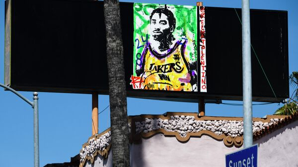 A painting of the late basketball icon Kobe Bryant by @reenatolentino is seen in Hollywood, California, April 23, 2020. - Three months after his death nearly 100 items of Bryant memorabilia, including NBA Finals game-worn sneakers, game jerseys and a championship ring are going on the auction block in a sale by goldinauctions.com ending on May 16, according to ESPN. (Photo by Robyn Beck / AFP) / RESTRICTED TO EDITORIAL USE - MANDATORY MENTION OF THE ARTIST @reenatalentino UPON PUBLICATION - TO ILLUSTRATE THE EVENT AS SPECIFIED IN THE CAPTION