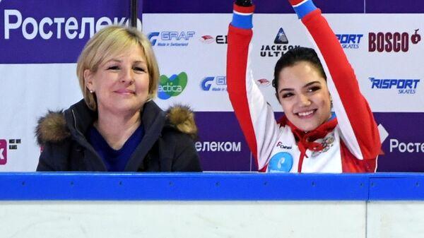 Трэйси Уилсон и Евгения Медведева (справа)