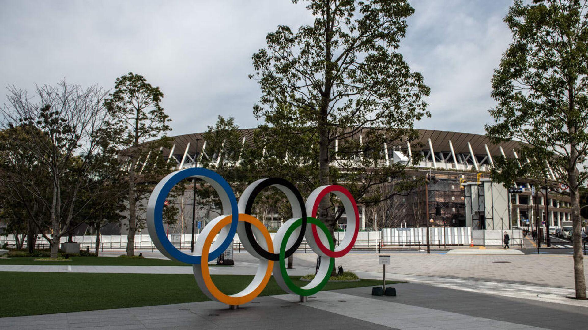 Олимпийские кольца у арены в Токио - РИА Новости, 1920, 13.11.2020