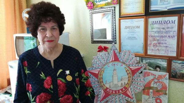 Галина Николаевна со своими наградами