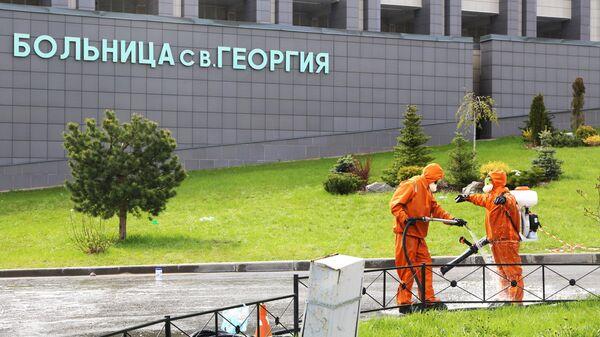 Дезинфекция территории больницы Святого Георгия в Санкт-Петербурге после тушения пожара