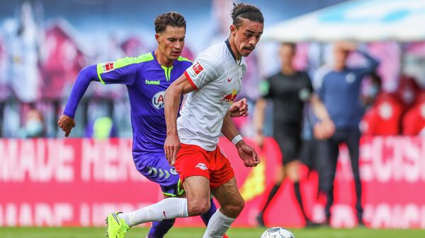 Freiburg's German defender Robin Koch (L) and Leipzig's Danish forward Yussuf Poulsen vie for the ball during the German first division Bundesliga football match RB Leipzig v SC Freiburg on May 16, 2020 in Leipzig, eastern Germany as the season resumed following a two-month absence due to the novel coronavirus COVID-19 pandemic. (Photo by Jan Woitas / POOL / AFP) / DFL REGULATIONS PROHIBIT ANY USE OF PHOTOGRAPHS AS IMAGE SEQUENCES AND/OR QUASI-VIDEO