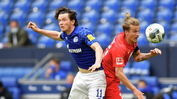 Schalke's Austrian forward Michael Gregoritsch (L) and Augsburg's Croation defender Tin Jedvaj jump for the ball during the German first division Bundesliga football match FC Schalke 04 v FC Augsburg on May 24, 2020 in Gelsenkirchen, western Germany. (Photo by Martin Meissner / POOL / AFP) / DFL REGULATIONS PROHIBIT ANY USE OF PHOTOGRAPHS AS IMAGE SEQUENCES AND/OR QUASI-VIDEO