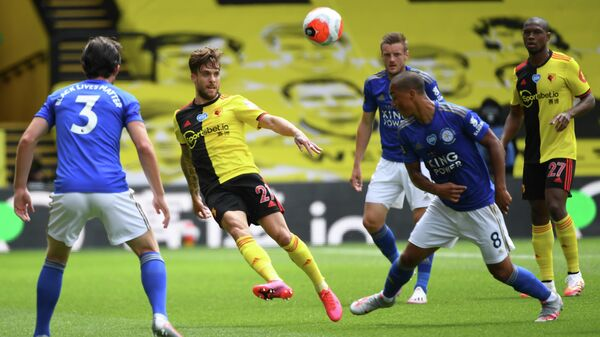 Watford's Spanish defender Kiko Femenia (2L) clears the ball during the English Premier League football match between Watford and Leicester City at Vicarage Road Stadium in Watford, north of London on June 20, 2020. (Photo by ANDY RAIN / POOL / AFP) / RESTRICTED TO EDITORIAL USE. No use with unauthorized audio, video, data, fixture lists, club/league logos or 'live' services. Online in-match use limited to 120 images. An additional 40 images may be used in extra time. No video emulation. Social media in-match use limited to 120 images. An additional 40 images may be used in extra time. No use in betting publications, games or single club/league/player publications. /
