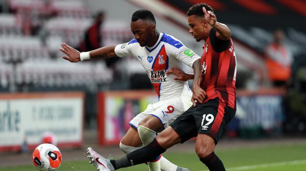 Crystal Palace's French-born Ghanaian striker Jordan Ayew (L) is challenged by Bournemouth's English midfielder Junior Stanislas during the English Premier League football match between Bournemouth and Crystal Palace at the Vitality Stadium in Bournemouth, southern England on June 20, 2020. (Photo by Ian Walton / POOL / AFP) / RESTRICTED TO EDITORIAL USE. No use with unauthorized audio, video, data, fixture lists, club/league logos or 'live' services. Online in-match use limited to 120 images. An additional 40 images may be used in extra time. No video emulation. Social media in-match use limited to 120 images. An additional 40 images may be used in extra time. No use in betting publications, games or single club/league/player publications. /