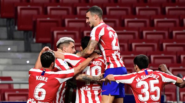 Atletico Madrid's players celebrate after Spanish midfielder Vitolo scored during the Spanish League football match between Atletico Madrid and Real Valladolid at the Wanda Metropolitan stadium in Madrid on June 20, 2020. (Photo by JAVIER SORIANO / AFP)