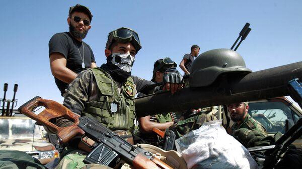 Члены Ливийской национальной армии в городе Бенгази