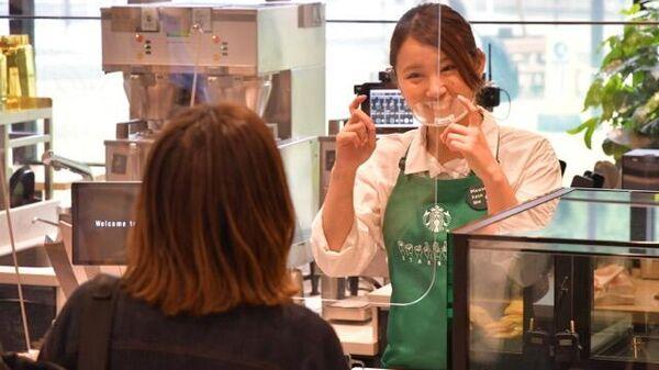 Первое в Японии кафе, где персонал и посетители общаются на сурдоязыке
