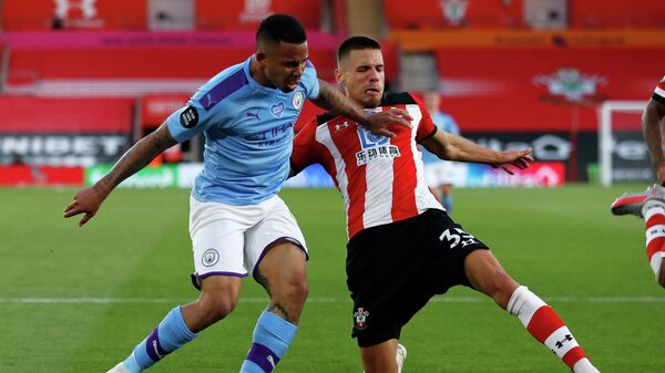 Southampton's Polish defender Jan Bednarek (R) blocks the ball in front of Manchester City's Brazilian striker Gabriel Jesus (L) during the English Premier League football match between Southampton and Manchester City at St Mary's Stadium in Southampton, southern England on July 5, 2020. (Photo by Frank Augstein / POOL / AFP) / RESTRICTED TO EDITORIAL USE. No use with unauthorized audio, video, data, fixture lists, club/league logos or 'live' services. Online in-match use limited to 120 images. An additional 40 images may be used in extra time. No video emulation. Social media in-match use limited to 120 images. An additional 40 images may be used in extra time. No use in betting publications, games or single club/league/player publications. /