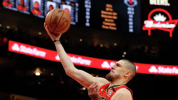 Украинский баскетболист Алексей Лень в матче НБА