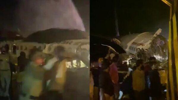 Спасатели тушат расколовшийся после посадки пассажирский самолет в Индии