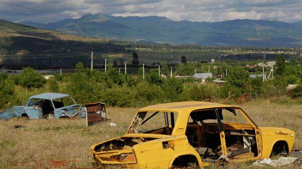 Кладбище автомобилей, в каждом из которых во время военных действий в августе 2008 года погибли жители города Цхинвали