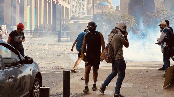 Участники столкновений между демонстрантами и силовиками в Бейруте