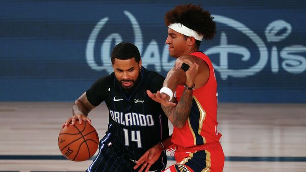 LAKE BUENA VISTA, FLORIDA - AUGUST 13: D.J. Augustin #14 of the Orlando Magic drives against Frank Jackson #15 of the New Orleans Pelicans during the second half of an NBA basketball game at the ESPN Wide World Of Sports Complex on August 13, 2020 in Lake Buena Vista, Florida. NOTE TO USER: User expressly acknowledges and agrees that, by downloading and or using this photograph, User is consenting to the terms and conditions of the Getty Images License Agreement.   Kim Klement-Pool/Getty Images/AFP