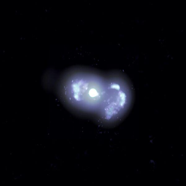 Многочастотное составное VLBA-изображение галактики TXS 0128+554, расположенной на расстоянии 500 миллионов световых лет от Земли