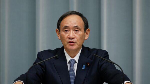 Генеральный секретарь Кабинета министров Японии Ёсихидэ Суга