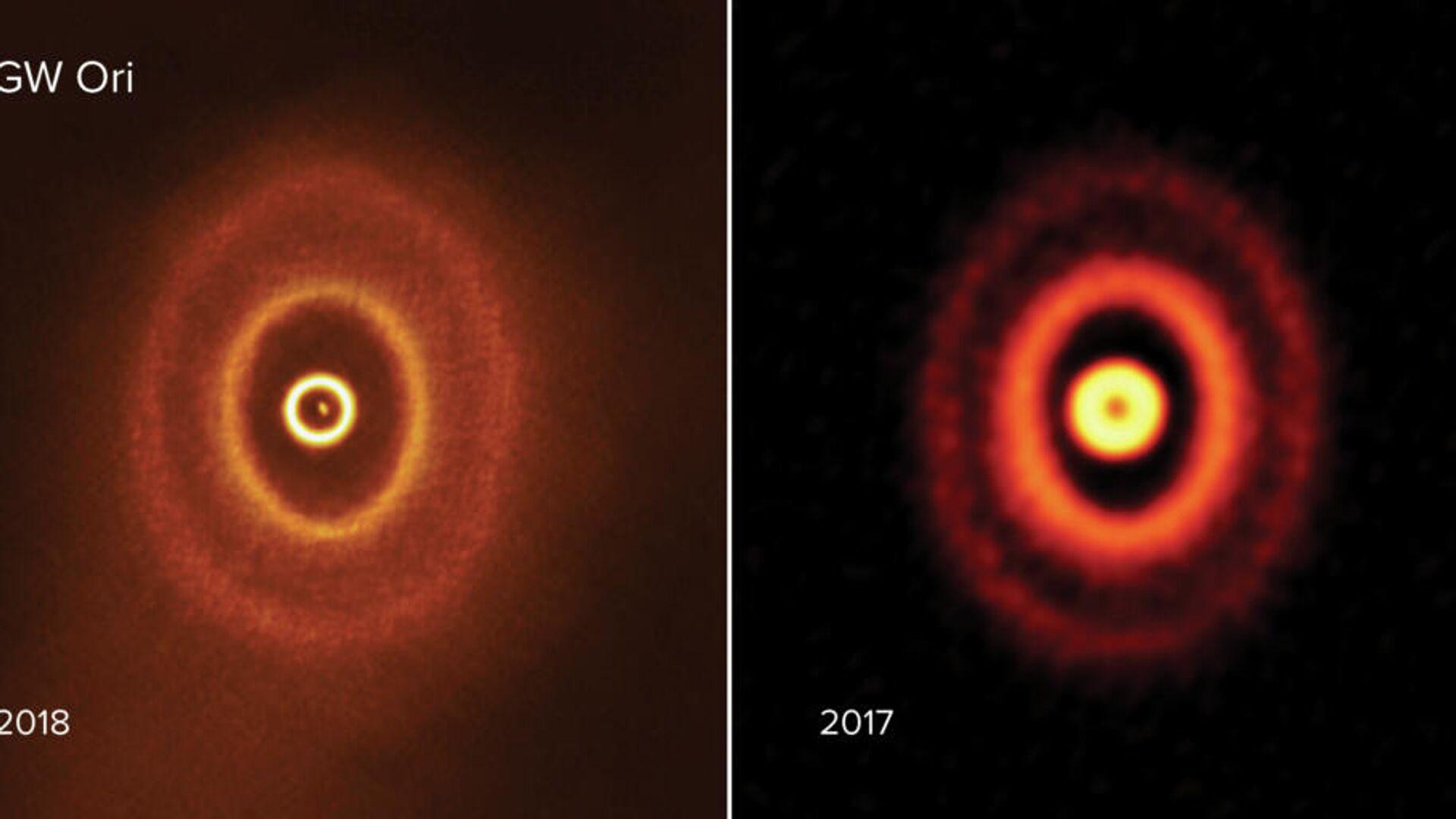 Изображения протопланетного диска тройной звездной системы GW Ориона, полученные радиотелексопом ALMA в 2018 и 2017 годах - РИА Новости, 1920, 03.09.2020