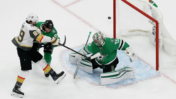 September 12, 2020; Edmonton, Alberta, CAN; Vegas Golden Knights right wing Alex Tuch (89) shoots against the defense of Dallas Stars defenseman Esa Lindell (23) as goaltender Anton Khudobin (35) defends the goal during the first period in game four of the Western Conference Final of the 2020 Stanley Cup Playoffs at Rogers Place. Mandatory Credit: Perry Nelson-USA TODAY Sports