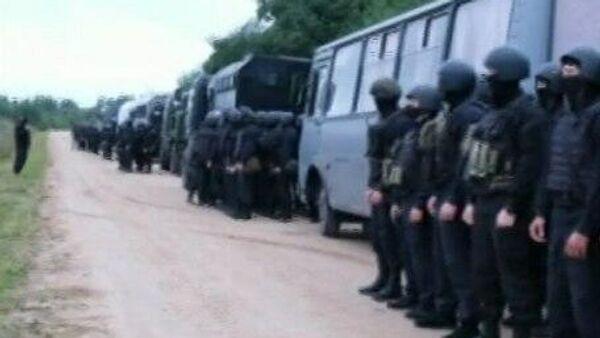 Сосредоточенные у белорусской границы российские силовики возвращаются в места постоянной дислокации. Кадр видео
