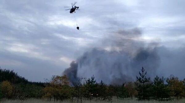 Кадры тушения пожара с воздуха в Воронежской области