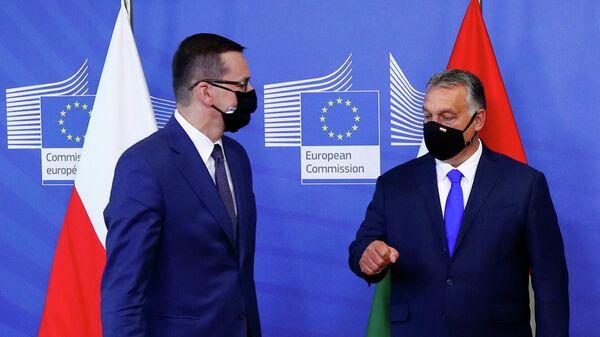 Премьер-министр Польши Матеуш Моравецки и премьер-министр Венгрии Виктор Орбан перед встречей с президентом Европейской комиссии в Брюсселе