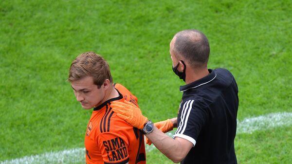 Андрей Панюков (слева)