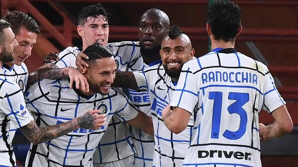 Inter Milan's team congratulates Italian defender Danilo D'Ambrosio (3rd L) after he scored the team's second goal during the Italian Serie A football match Genoa vs Inter Milan at the Luigi-Ferraris Stadium in Genoa, on October 24, 2020. (Photo by MARCO BERTORELLO / AFP)