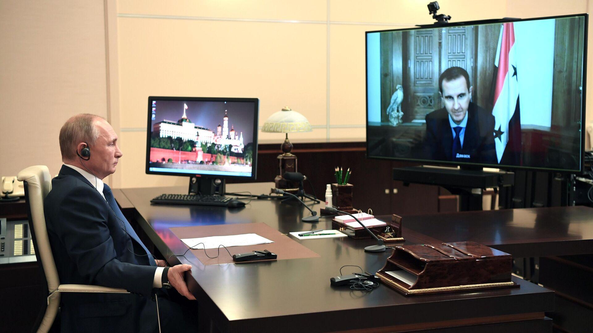 Президент РФ Владимир Путин во время встречи в режиме телемоста с президентом Сирии Башаром Асадом - РИА Новости, 1920, 09.11.2020