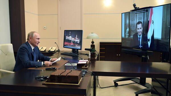 Президент РФ В. Путин провел встречу в режиме телемоста с президентом Сирии Башаром Асадом