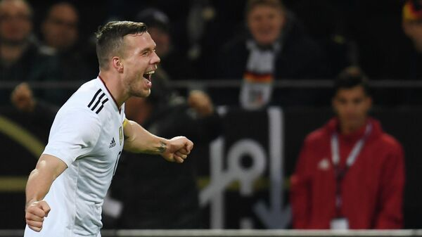 Germany's midfielder Lukas Podolski celebrates after scoring during a friendly football match between Germany and England on March 22, 2017 in Dortmund, western Germany. - It is Lukas Podolski's last match with the German team. (Photo by PATRIK STOLLARZ / AFP)