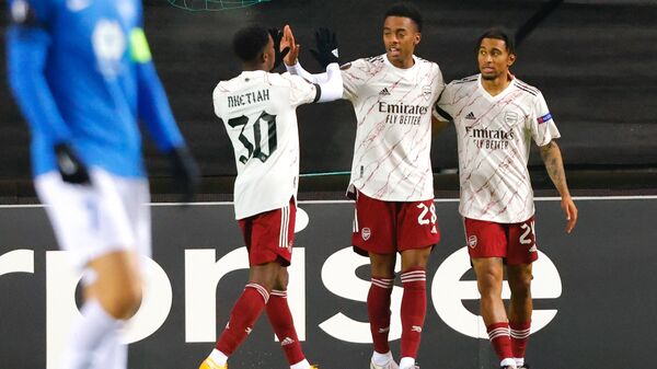 Arsenal's English midfielder Reiss Nelson (R) celebrates with Arsenal's English striker Eddie Nketiah (L) and Arsenal's English midfielder Joe Willock (R) after scoring the 0-2 during the UEFA Europa League group B football match  Molde v Arsenal in Molde, Norway on November 26, 2020. (Photo by Svein Ove Ekornesvеg / NTB / AFP) / Norway OUT