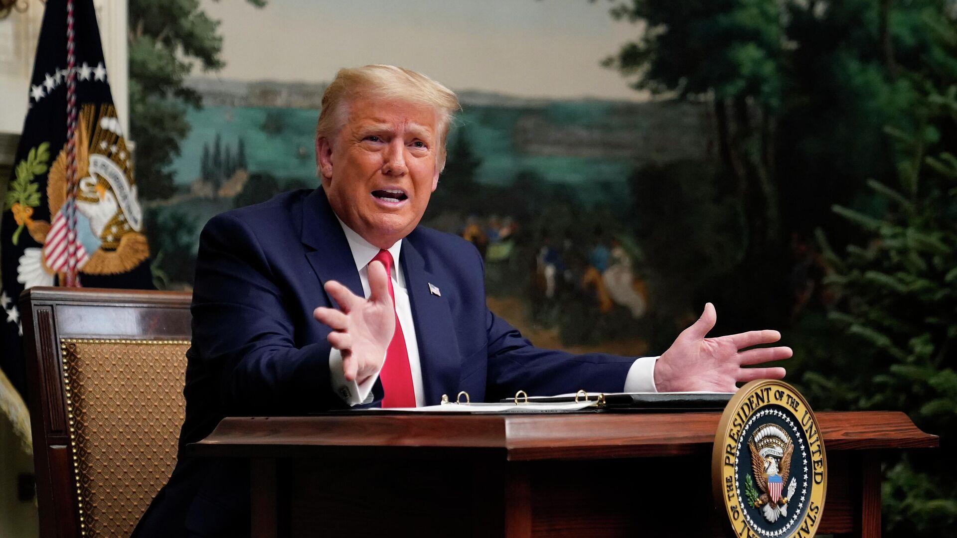 Президент США Дональд Трамп во время телеконференции в Белом доме - РИА Новости, 1920, 27.11.2020