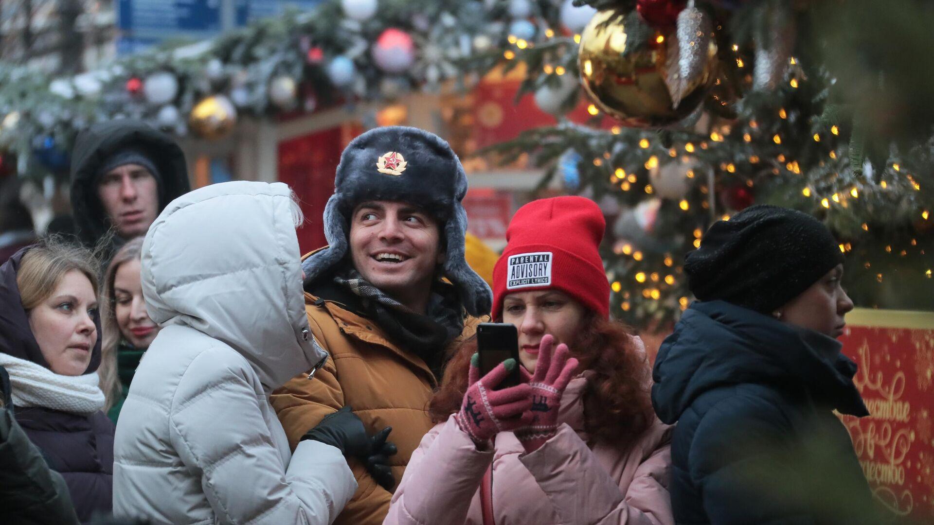 Иностранные туристы на фестивале Путешествие в Рождество в Москве - РИА Новости, 1920, 15.12.2020
