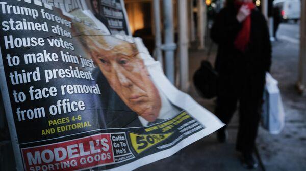 Газета с портретом президента США Дональда Трампа в Нью-Йорке