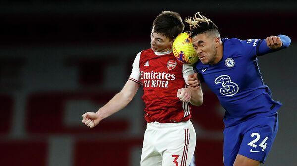 Arsenal's Scottish defender Kieran Tierney (L) and Chelsea's English defender Reece James compete during the English Premier League football match between Arsenal and Chelsea at the Emirates Stadium in London on December 26, 2020. (Photo by ANDREW BOYERS / POOL / AFP) / RESTRICTED TO EDITORIAL USE. No use with unauthorized audio, video, data, fixture lists, club/league logos or 'live' services. Online in-match use limited to 120 images. An additional 40 images may be used in extra time. No video emulation. Social media in-match use limited to 120 images. An additional 40 images may be used in extra time. No use in betting publications, games or single club/league/player publications. /