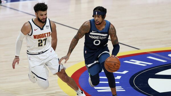 DENVER, COLORADO - JANUARY 05: D'Angelo Russell #0 of the Minnesota Timberwolves drives against Jamal Murray #27 of the Denver Nuggets in the third quarter at Ball Arena on January 05, 2021 in Denver, Colorado. NOTE TO USER: User expressly acknowledges and agrees that, by downloading and or using this photograph, User is consenting to the terms and conditions of the Getty Images License Agreement.   Matthew Stockman/Getty Images/AFP