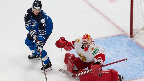 EDMONTON, AB - JANUARY 05: Goaltender Yaroslav Askarov #1 of Russia skates against Henri Nikkanen #28 of Finland during the 2021 IIHF World Junior Championship bronze medal game at Rogers Place on January 5, 2021 in Edmonton, Canada.   Codie McLachlan/Getty Images/AFP