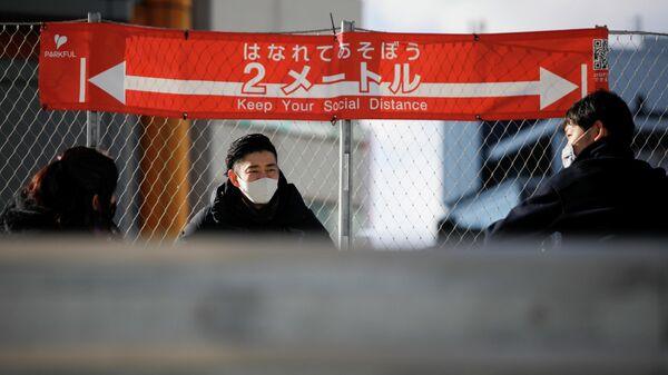 Призыв к социальному дистанцированию в столице Японии после того, как было объявлено чрезвычайное положение