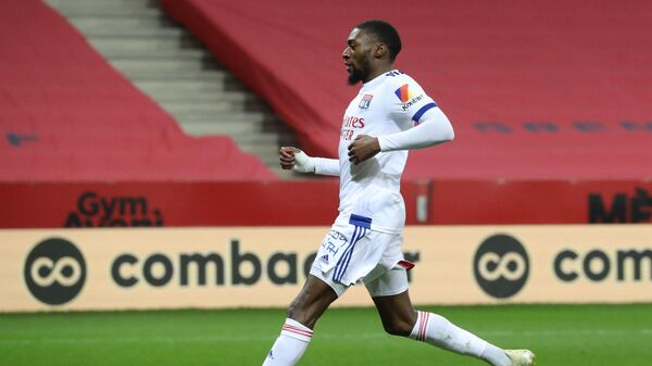 Lyon's Cameroonian forward Karl Toko Ekambi celebrates after scoring a goal during the French L1 football match between OGC Nice and Olympique Lyonnais at the Allianz Riviera stadium in Nice, on December 19, 2020. (Photo by Valery HACHE / AFP)