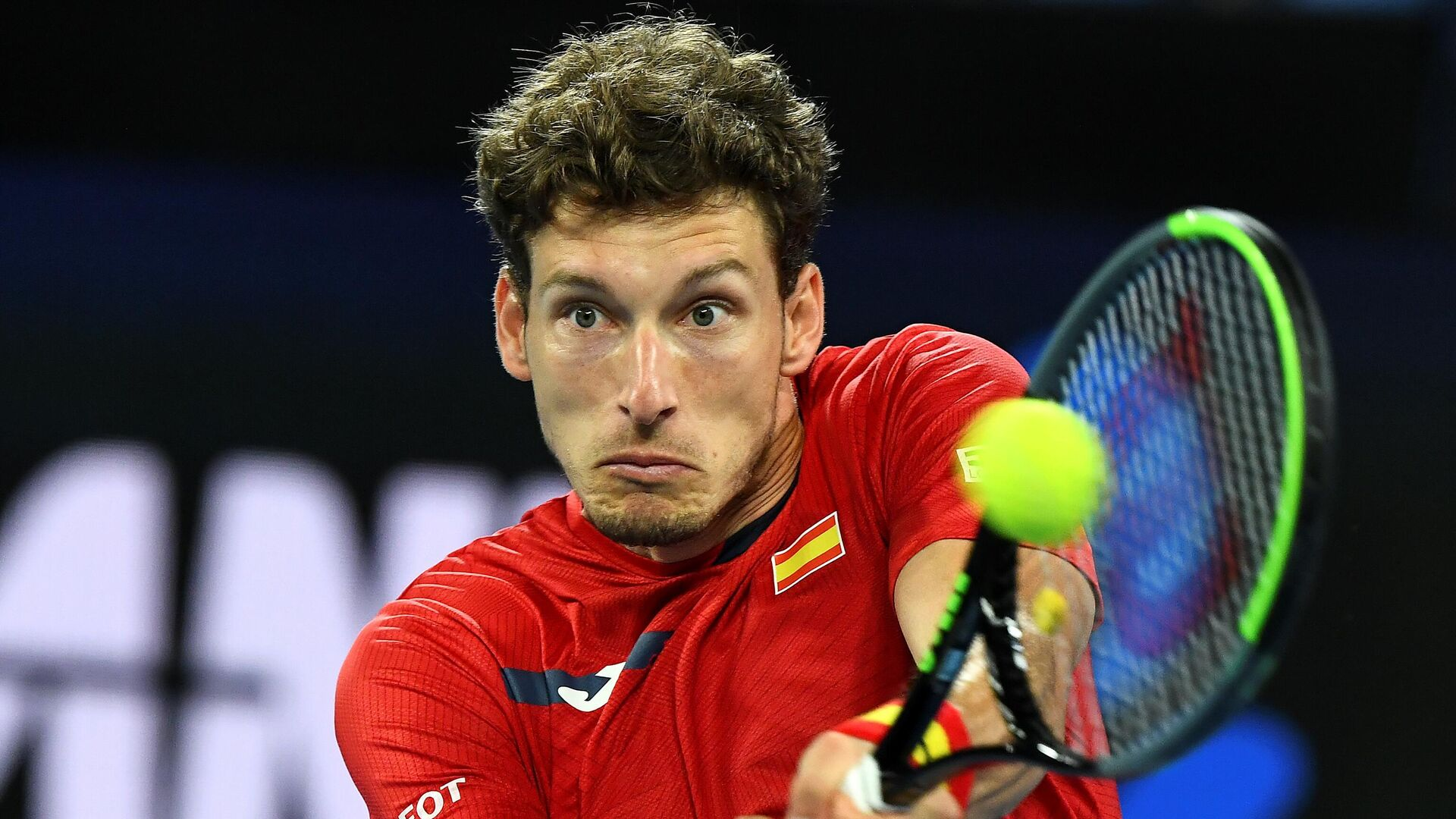 Spain's Pablo Carreno Busta hits a return against Greece's Michail Pervolarakis during their group B ATP Cup singles match in Melbourne on February 5, 2021. (Photo by William WEST / AFP) / -- IMAGE RESTRICTED TO EDITORIAL USE - STRICTLY NO COMMERCIAL USE -- - РИА Новости, 1920, 05.02.2021