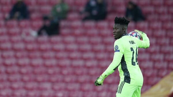 Ajax's Cameroon goalkeeper Andre Onana throws the ball during the UEFA Champions League 1st round Group D football match between Liverpool and Ajax at Anfield  in Liverpool, north west England on December 1, 2020. (Photo by Jon Super / POOL / AFP)