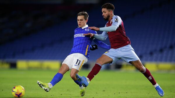 Aston Villa's Brazilian midfielder Douglas Luiz (R) pressures Brighton's Belgian midfielder Leandro Trossard (L) during the English Premier League football match between Brighton and Hove Albion and Aston Villa at the American Express Community Stadium in Brighton, southern England on February 13, 2021. (Photo by ANDREW COULDRIDGE / POOL / AFP) / RESTRICTED TO EDITORIAL USE. No use with unauthorized audio, video, data, fixture lists, club/league logos or 'live' services. Online in-match use limited to 120 images. An additional 40 images may be used in extra time. No video emulation. Social media in-match use limited to 120 images. An additional 40 images may be used in extra time. No use in betting publications, games or single club/league/player publications. /